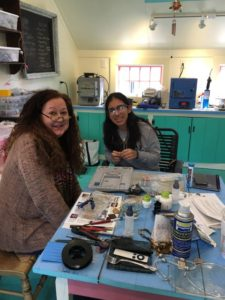 Kim in her studio with her student mentee Ana Batson